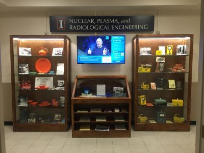 This display of nuclear artifacts on the west entrance to Talbot Laboratory's second floor features momentos and a video of the TRIGA reactor.