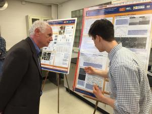 2016 NPRE Distinguished Alumni Award winner Stephen Coggeshall viewed student posters during events held in April in NPRE.