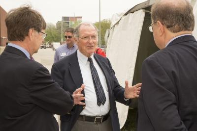 George Miley, center, chats with NPRE Department Head Jim Stubbins, left, and Eugene Grecheck, president of the American Nuclear Society, right, during the dedication of the former TRIGA reactor as an ANS National Nuclear Historic Landmark. Miley, who did much of his research on the former facility, which had been located on the Engineering campus' east side, had nominated TRIGA for the honor.