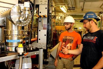 Matthew Parsons, left, and Daniel Andruczyk discuss working on HIDRA.