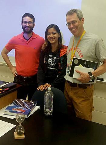 Alyssa Hayes with Warren Township High School physics teachers Louie Klein (left) and Pieter Kreunan (right).