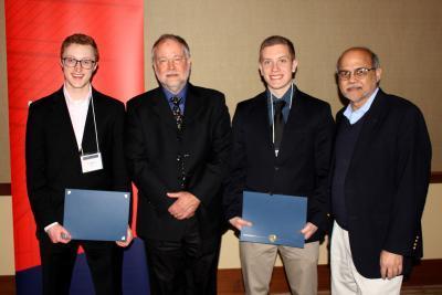 From left, 2018 Taber Scholar Connor Daly, NPRE alumnus Brad Radl, 2018 Taber Scholar Joe Darga, and NPRE Department Head Rizwan Uddin