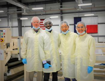 Chinedu Oputa, second from left, while working over the summer on the Texas Military Department project.