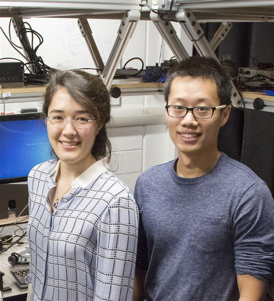 Illinois Physics Professor Virginia Lorenz and her graduate student Wenrui Wang pose in her laboratory at the Loomis Laboratory of Physics in Urbana. Photo by L. Brian Stauffer, University of Illinois at Urbana-Champaign