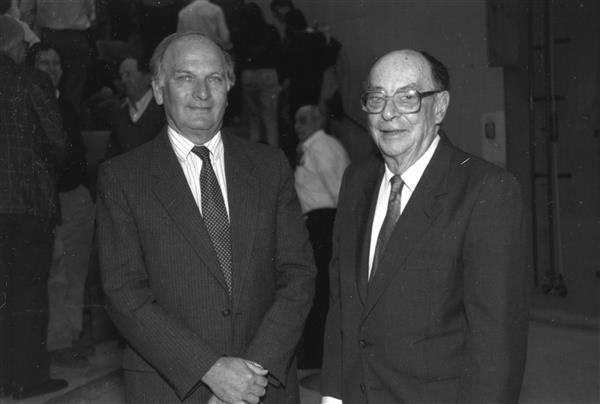 John Robert Schrieffer (left) and John Bardeen at event. Illinois Physics, scanned at the AIP Emilio Segrè Visual Archives
