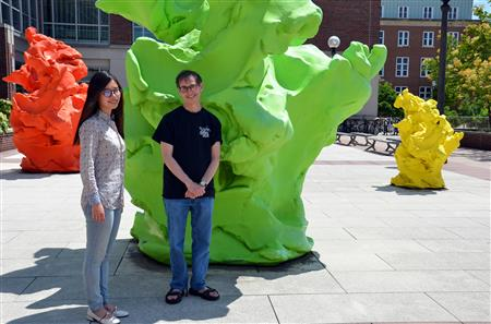 Professor Nigel Goldenfeld (right) and his graduate student Minhui Zhu pose outside the Institute for Genomic Biology on the University of Illinois at Urbana-Champaign Campus. Goldenfeld and Zhu elucidated the experimental observations using a theory borrowed from the field of soft condensed matter, establishing that charge order stripe formation in cuprate superconductors adhere to a universal scaling law, akin to pattern formation in liquids and polymers. Photo by Siv Schwink, Illinois Physics