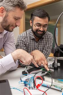 Researchers working on skimmers.