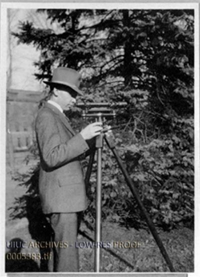 Adjusting a level, circa 1917