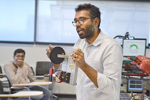 ECE ILLINOIS Assistant Professor Subhonmesh Bose does a demo for the educators.