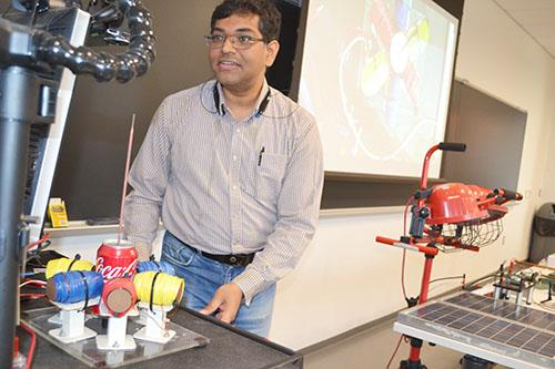 ECE ILLINOIS Assistant Professor Arijit Banerjee does a power demo for the educators.