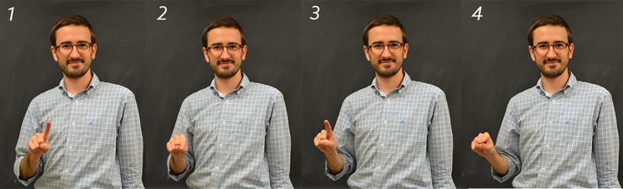 Illinois Physics graduate student Colin Lualdi demonstrates the sign for 'photon,' which evokes its dual wave-particle nature. This is among the newer signs that Deaf physicists have started to adopt.