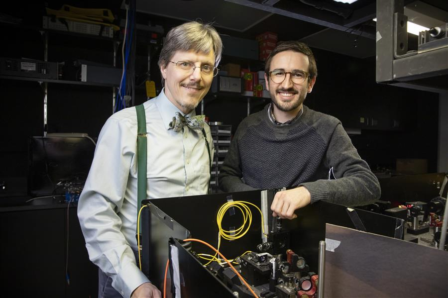 Physics Professor Paul Kwiat (left) and graduate student Colin Lualdi pose in the laboratory at the Loomis Laboratory of Physics in Urbana. Photo by L. Brian Stauffer, University of Illinois at Urbana-Champaign