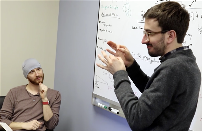 Illinois Physics graduate student Colin Lualdi works with colleague David Spiecker during an ASL Clear development session at the Center for Research and Training at the Learning Center for the Deaf in Framingham, MA. Photo by Jonah Meehan, Center for Research and Training
