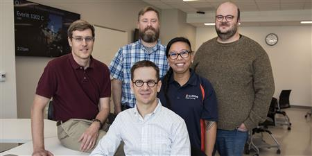 CBTF founders, Craig Zilles, far left, Matthew West, foreground center, and David Mussulman, back row second from left, join administrative team members, Carleen Sacris and Patrick Bailey, far right.