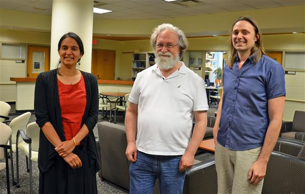 (L-R) Illinois Physics Professors Smitha Vishveshwara, Eduardo Fradkin, and Taylor Hughes pose in the common room of the Institute for Condensed Matter Theory (ICMT) in Urbana. Vishveshwara and Hughes are co-PI and PI respectively on the Moore Foundation grant; Fradkin is the the director of the ICMT. Photo by Siv Schwink for Illinois Physics