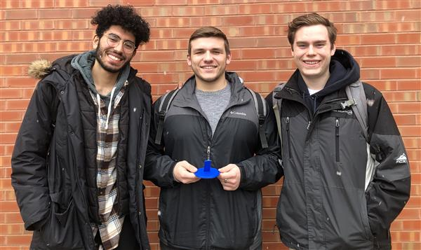 Arsanious Boctor, Spencer Binning and Matthew Meyer stand with a prototype of their product, LidLock.