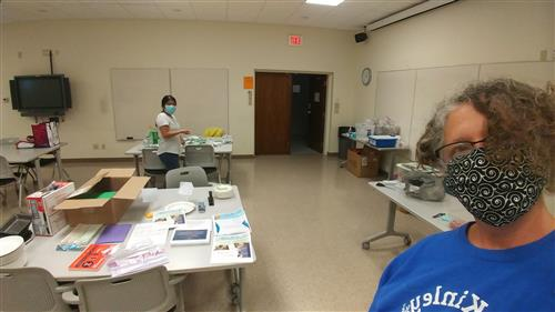 Lara Hebert and the outreach staff prepare STEM kits.