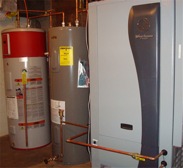 The Water Furnace 7 Series heat pump, the heart of the geothermal system. Also shown are the preheat tank (gray) and the water heater (white and red), which are discussed below.