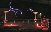 Mark Smart (far right) plays the Continuum Fingerboard as the Tesla coils fire behind him.