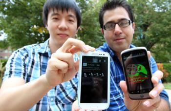 Hyungchul Yoon, left, and Reza Shiftehfar display screen shots from the smart phone app they developed to assist emergency personnel in rescuing people trapped in buildings after disasters.