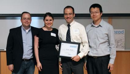 (l to r) TEC Asst. Director Jed Taylor and Masha Trenhaile, Fox Development Corp., present the Most Fundable Venture Prize to Seritonix teammates Jim Langer and Weihua Zheng.
