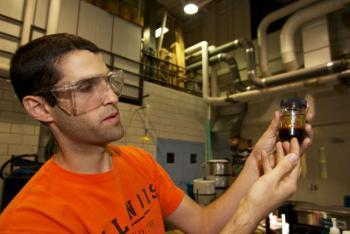 Matt Giannis, one of the IBI project leaders, examines one of the by-products of the filtering process.