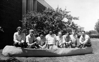 The first concrete canoe team poses on the lawn at Newmark Civil Engineering Lab. Participants included: Rocco Gibala, Mike Novak, Bill Rettberg, Rick Rettberg, Jim Schmudde, Bill Wuellner (Some names of participants have been found but individuals cannot be identified.).