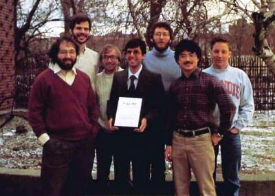 Illinois'  winning team (from left): Stephen Wolfram, Stephen Omohundro, Arch Robison (MS 87, PhD 90, CS), Steven Skiena (holding the TABLET) (MS 85, PhD 88, CS), Bartlett Mel (PhD 89, CS), Luke Young (PhD 93, EE), and Kurt Thearling (MS 88, PhD 90 EE).