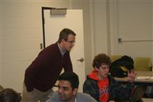 Professor Jeff Roesler helps students with their group project on sustainability.