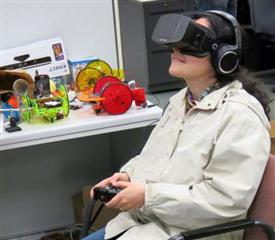 CS Assistant Prof. Svetlana Lazebnik tries out the prototype.