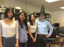 Seniors that designed a magic wands battle game Manfei Wu, Jialin Sun, and Shanoon Martin pose for a picture with professor Andrew C Singer.