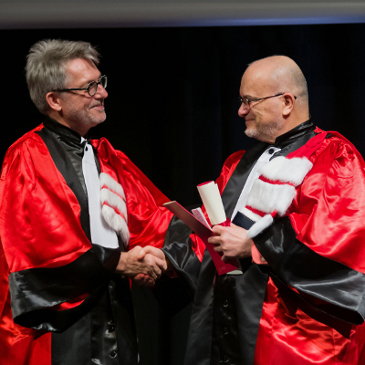 Professor Marc Snir, right, accepts congratulations from ENS de Lyon President Jean-Francois Pinton.