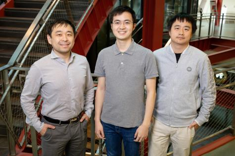 Natural Resources & Environmental Sciences Assistant Professor Kaiyu Guan, left, graduate student Yunan Luo and CS Assistant Professor Jian Peng have developed a new algorithm that solves an age-old dilemma plaguing satellite imagery – whether to sacrifice high spatial resolution in the interest of generating images more frequently, or vice versa. Their algorithm can generate daily continuous images going back to the year 2000.  Photo by L. Brian Stauffer