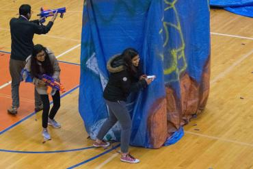 Hackers take a break for a Nerf battle in Kenney Gym.
