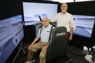 Rudy Frasca (seated) founded Frasca International in 1958. Today his son, John (standing), serves at the company's CEO.