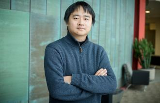 "Illinois computer science professor Jian Peng developed a tool to map a gene's ""social network,"" which could help researchers better understand its function and interactions, and provide insights into human disease and treatment.    Photo by L. Brian Stauffer"