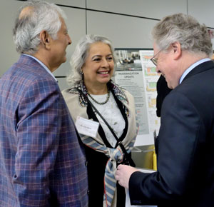 Smart Bridge donors Lalit Bahl and Kavita Kinra speak with Provost Andreas Cangellaris (right) before the groundbreaking ceremony.