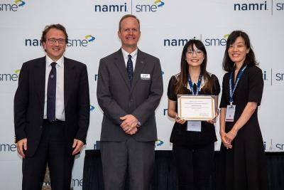 Ping-Ju Chen, second from right, receiving the student award.