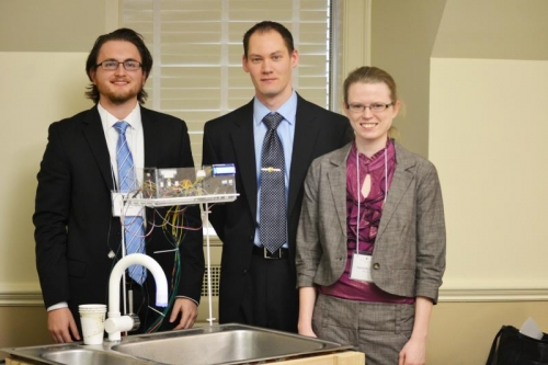 Timothy Jones, Kevin Kienitz, and Danielle Courtois with their touchless faucet prototype.