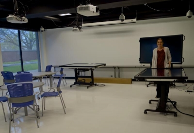 College of Education Professor Emma Mercier with her multi-touch tables in the lab classroom. Photo by Taylor Tucker.