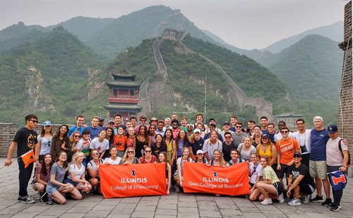 Group of Hoeft T&M students pose with College Engineering and Gies College of Business Banners in China