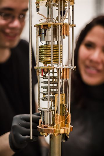 UIUC scientists working on dilution refrigerator in quantum lab.