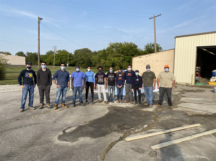CEE graduate students strike a pose after their hard work pouring concrete into slabs for the IDOT-sponsored project held at ICT on Sept. 22.
