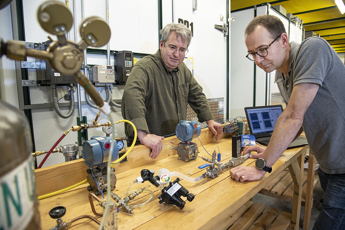 Greg Elliott, an Aerospace professor, and Stefan Elbel, a MechSE research assistant, evaluate performance of an Illinois RapidVent prototype using test lungs at the Creative Thermal Solutions facility in Urbana, IL..