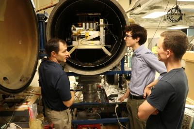 Associate Professor Joshua Rovey with graduate students in the aerospace propulsion lab