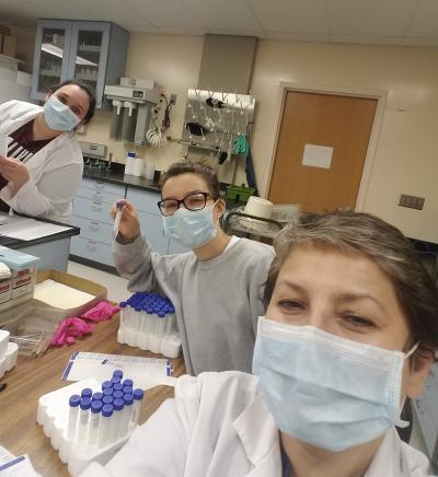 Left to right: SIUC graduate student Nita Shillova, U of I AE undergrad Zana Essmyer, and immunologist Vjollca Konjufca prepare vials with viral transport media for COVID-19 tests.