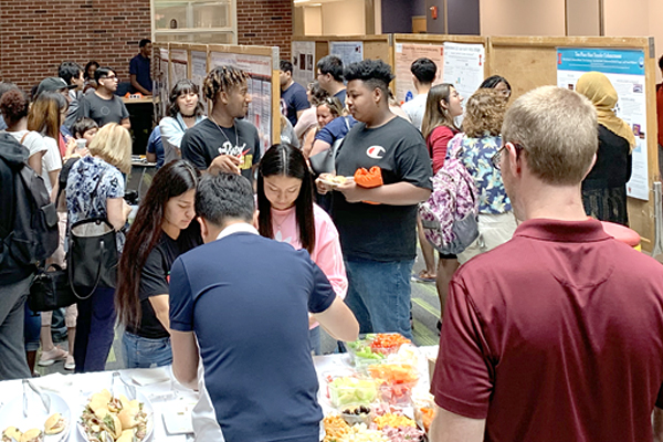 High school students discuss their 2019 WYSE research with other participants and UI faculty, staff and students.
