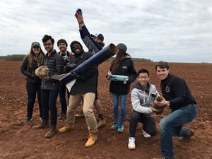 Javier Brown, center holding rocket, with the Student Launch Team at a competition in Alabama his junior year at Illinois.