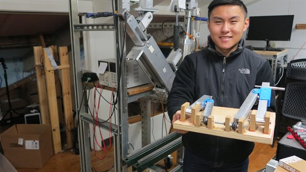 Michael Liao demonstrates his supension system for a solar-powered vehicle, created with an REU grant.