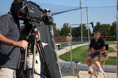 Alan M. Nathan, at the UIUC baseball stadium, being taped for a National Geographic television program on baseball; August 2006.